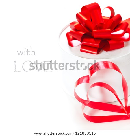 Valentine`s day. White gift box with red ribbon.
