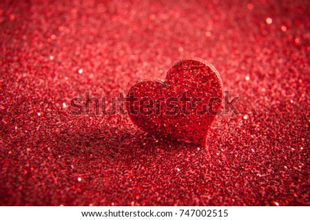 Valentines bright red heart on a red glitter background.  #747002515