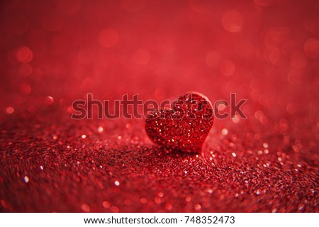 Valentines bright red heart on a red glitter background. Artistic romantic macro photo #748352473
