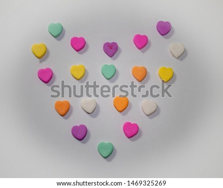 Valentines candy hearts in heart shape and Text Me text.