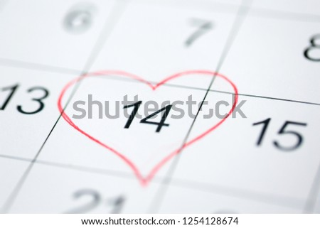 valentines day and holidays concept - close up of calendar sheet with 14th february date marked by red heart shape #1254128674