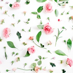 Valentines Day background. Floral pattern made of pink and beige roses, green leaves, branches on white background. Flat lay, top view. Valentine's background