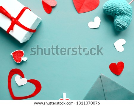 Valentines Day background. Hand made hearts and red giftboxes on blue background. Flat lay, top view, copy space #1311070076
