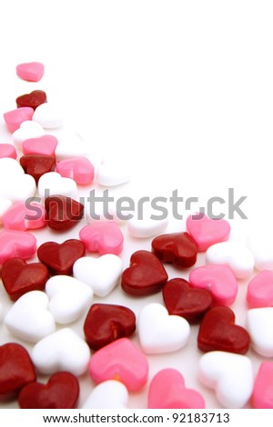 Valentines Day background or corner border of red, pink and white candies
