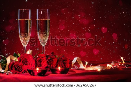 Valentines day background with champagne glasses and red roses