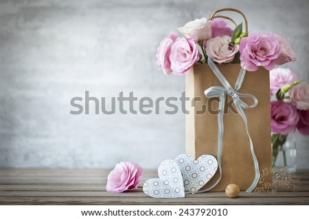 Valentines Day background with pink roses, bow and paper Hearts
