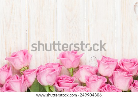 Valentines day background with pink roses over wooden table. Top view with copy space #249904306