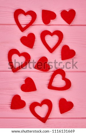 Valentines Day background with red hearts. Red heart shaped paper cutouts on wooden background, top view. Valentines holiday festive background. #1116131669