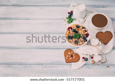 Valentines day breakfast with Muesli bowl berries and milk. Top view  #557577001