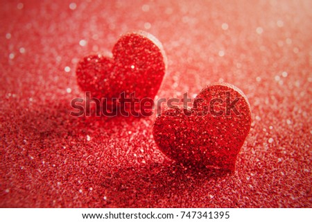 Valentines day bright red heart on a red glitter background. Artistic macro photo #747341395