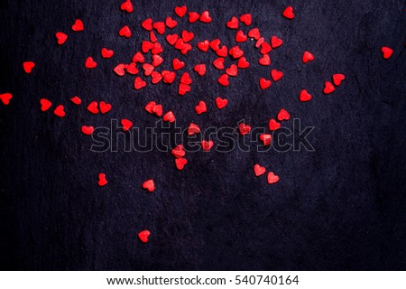 Valentines day Card  with red hearts on black background with copyspace for greeting text. #540740164