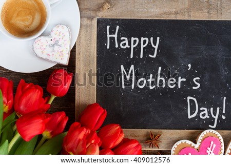 Valentines day coffee with red tulips bouquet, happy mothers day on blackboard #409012576