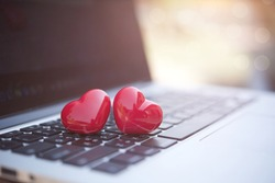 Valentines day concept. hearts on the computer keyboard with soft light background.