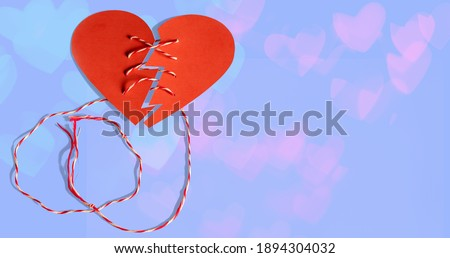 Valentines day concept,Paper cutting technique,A broken heart pulled by a rope. Stock photo ©