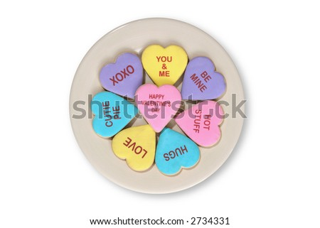 Valentines Day cookies on a plate isolated over white