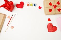 Valentines day craft top view. Handmade valentine card, DIY present. red hearts decoration on whitebackground. copy space