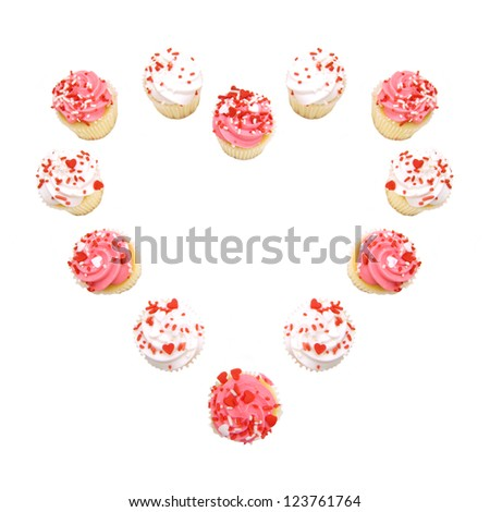 Valentines Day cupcakes arranged in a heart shape over white