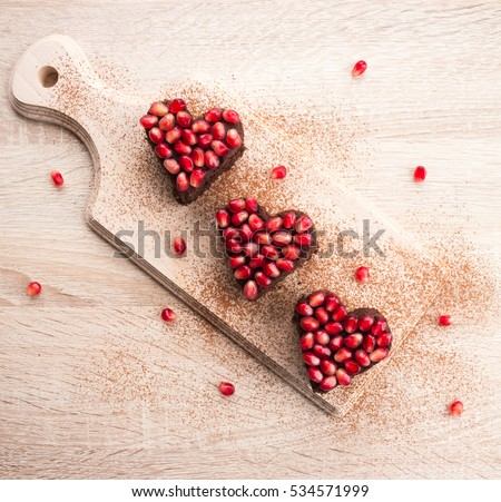 Valentines day dessert idea - heart shaped chocolate cake, blank space for text, top view. Love concept