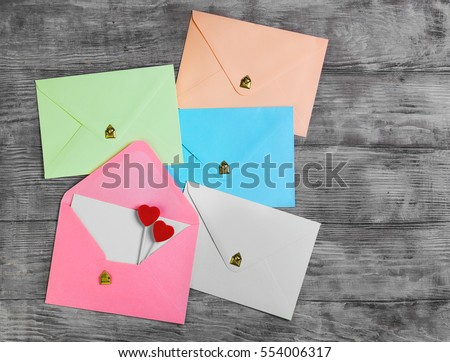 Valentines Day Envelope Mail, Red Heart. Valentine Letter Card, Wedding Love Concept in colorful letters envelopes. Gold seal with hearts valentine envelopes. Vintage white wood background. Top view