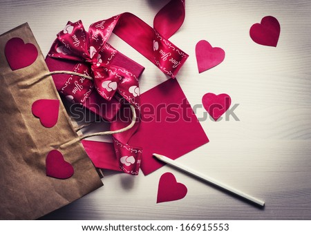 Valentines Day gift, hearts and greeting card on wooden plates in vintage style/ Valentines day background