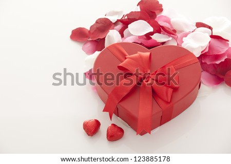 Valentines Day gift in red box with rose petal  isolated on white