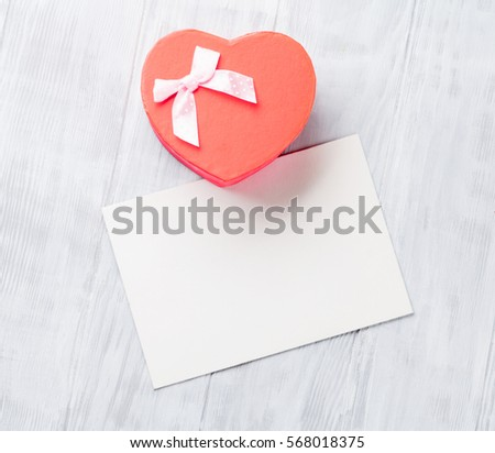 Valentines day greeting card and gift box on wooden table. Top view with space for your greetings  #568018375