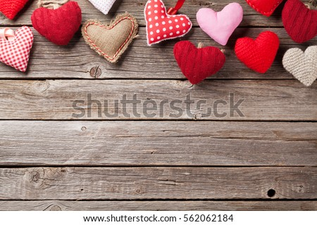 Valentines day greeting card. Handmaded hearts on wooden table. Top view with copy space