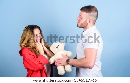 Valentines day holiday. Surprise for sweetheart. Soft toy teddy bear gift. Surprise gift concept. Surprising her. Handsome man and pretty girl in love. Man and woman couple in love. Romantic surprise.