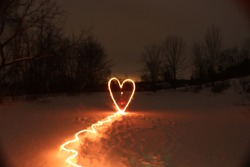 valentines day light painting of heart on frozen lake