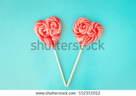 Valentines day lollipops on a blue background #552351022
