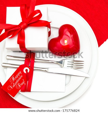 Valentines Day table place setting decoration in red and white. romantic candle light dinner. Happy Valentines Day!