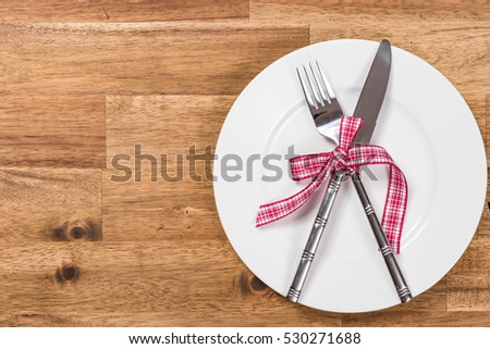 table setting background. valentines day table setting with plate, fork, knife and ribbon. background e