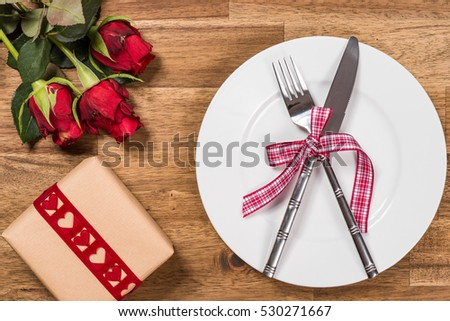 Valentines day table setting with plate, fork, knife, red hearts,  ribbon and roses. Valentines day background. Woman's day.Women's day.  #530271667