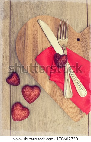 Valentines Day table setting with red heart decoration