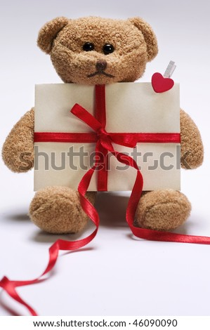stock photo : valentines day teddy bear holding envelope with decorative red