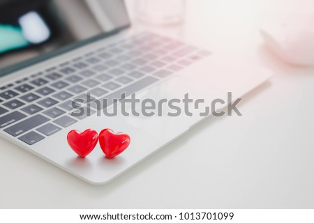 Valentines Day theme,Couple red hearts on laptop on white table in office.Concept of Online dating. #1013701099