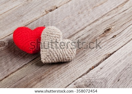 Valentines day toy hearts on wooden table. View with copy space