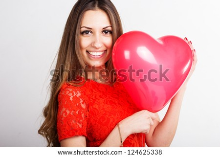 Valentines day woman holding red heart balloon