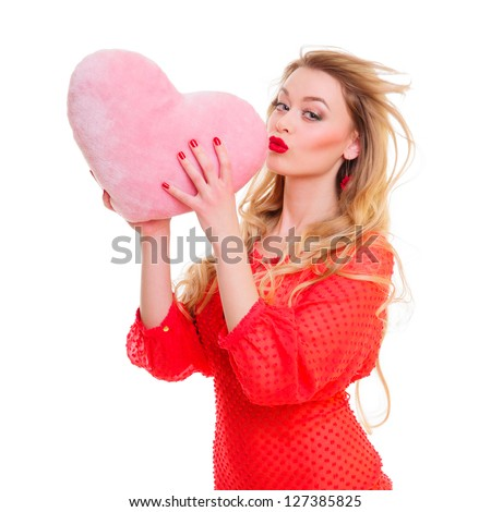 Valentines Day. Woman holding Valentines Day heart sign with copy space. positive portrait  blonde