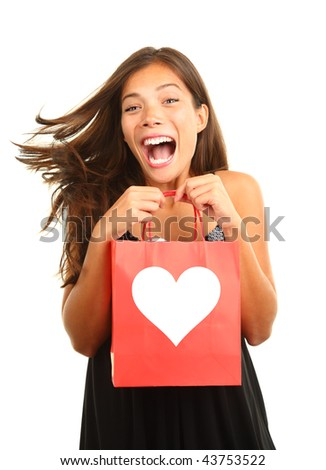 Valentines day woman very happy and excited for her gift / present. Beautiful mixed race asian / caucasian model isolated on white background.