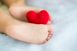Valentune's Day,Baby's feet with a red heart