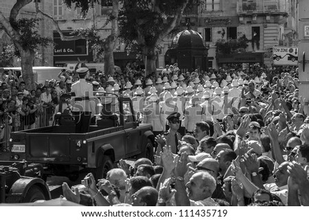 VALETTA, MALTA - AUG 25 - The corteo and coffin arrive in St John's Square during the state funeral of former Prime Minister Dom Mintoff in Valletta on 25 August 2012