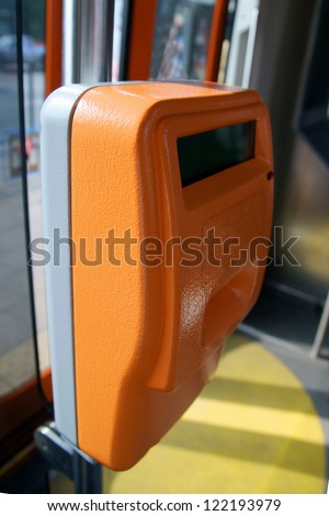 validating machine in trolley, streetcar, tramway. City train interior