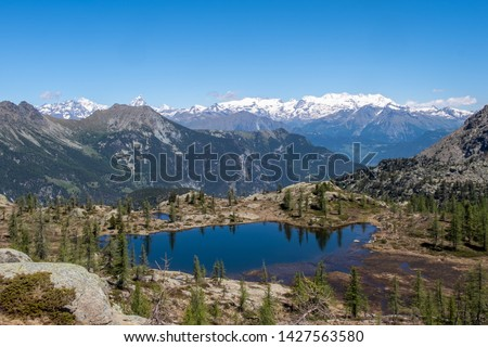 Valletta Lake and Monte Rosa, with Matterhorn, Mont Avic Park, between Champorcher Valley and Champdepraz Valley, Aosta Valley, Italy #1427563580