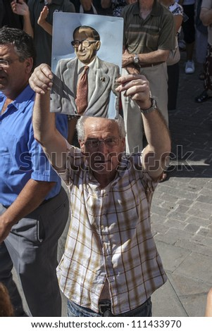 VALLETTA, MALTA - AUG 25 - A Labour supporter holds up a picture during the state funeral of former Prime Minister of Malta Dom Mintoff in Valletta on 25 August 2012