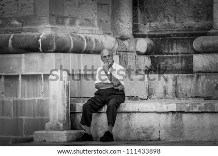 VALLETTA, MALTA - AUG 25 - A senior citizen is lost in thought during the state funeral of former Prime Minister of Malta Dom Mintoff in Valletta on 25 August 2012