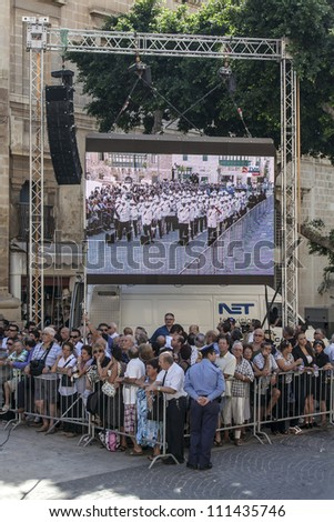 VALLETTA, MALTA - AUG 25 - Details from the large crowd during the state funeral of former Prime Minister of Malta Dom Mintoff in Valletta on 25 August 2012