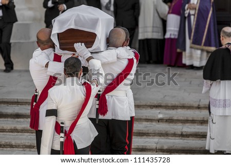 VALLETTA, MALTA - AUG 25 - Military pallbearers from the AFM carry former Prime Minister of Malta Dom Mintoff into the Cathedral during his state funeral on 25 August 2012