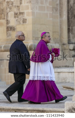 VALLETTA, MALTA - AUG 25 - The Archbishop of Malta Paul Cremona arrives for the state funeral of former Prime Minister Dom Mintoff in Valletta on 25 August 2012