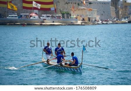 VALLETTA, MALTA - SEPTEMBER 8: traditional boats regatta in Valletta in Mediterranean sea on Sep 8, 2013. Popular regatta in Malta. Traditional sport in Malta. Boat team. Kalkara